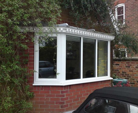 A uPVC Casement Window in York with ivy growing along one side